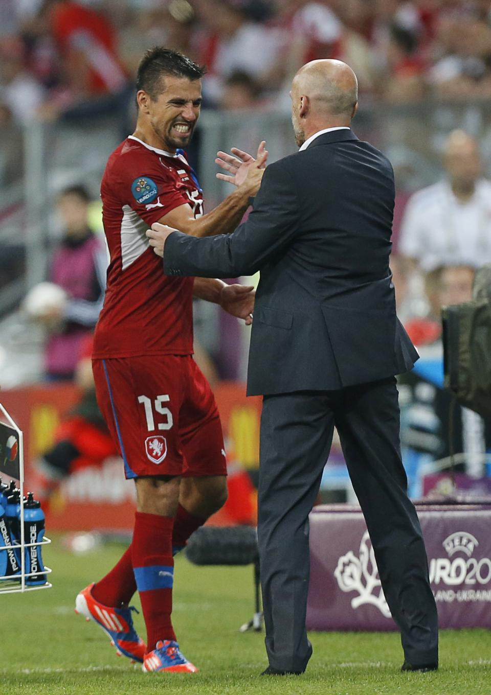 Czech Republic's Milan Baros shakes hands with head coach Michal Bilek during the Euro 2012 soccer championship Group A match between Czech Republic and Poland in Wroclaw, Poland, Saturday, June 16, 2012. (AP Photo/Jon Super)