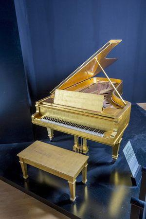 Elvis Presley's gold grand piano, Beatles drum skin up for auction