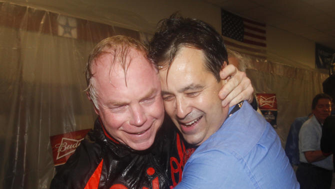 Baltimore Orioles Buck Showalter, left, and general manager Dan Duquette celebrate winning the American League wild-card playoff baseball game 5-1, against the Texas Rangers early Saturday, Oct. 6, 2012 in Arlington, Texas. (AP Photo/Tony Gutierrez)