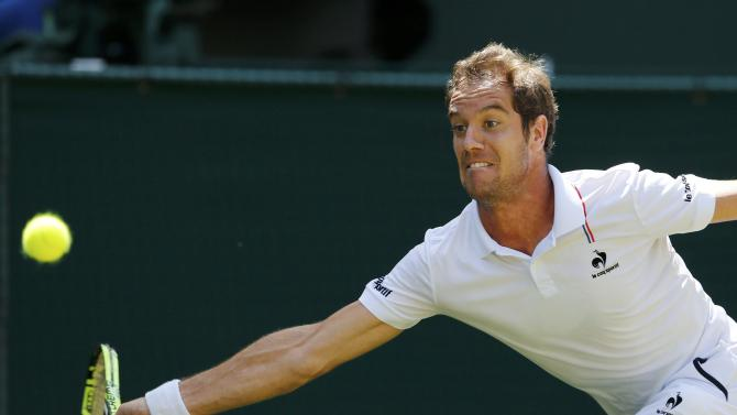 Richard Gasquet of France hits a shot during his match against Grigor Dimitrov of Bulgaria at the Wimbledon Tennis Championships in London