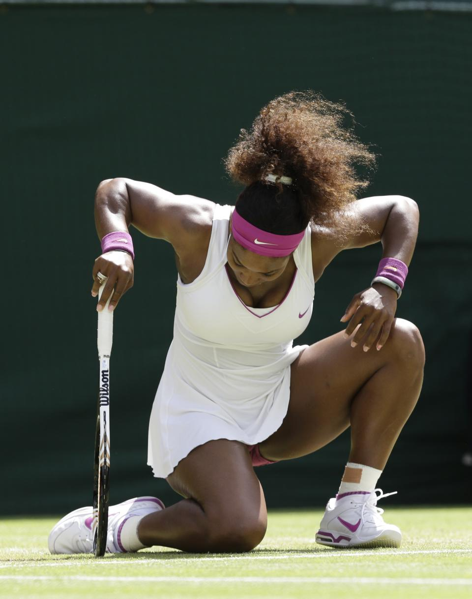Serena Williams of the United States gets up after playing a return to Zheng Jie of China during a third round women's singles match at the All England Lawn Tennis Championships at Wimbledon, England, Saturday, June 30, 2012. (AP Photo/Anja Niedringhaus)