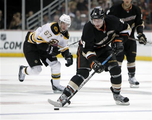 Turco gets 1st win with Bruins, beating Ducks 3-2