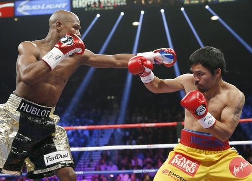 Pacquiao says shoulder injury limited him in Mayweather loss