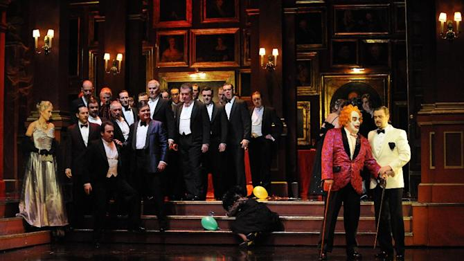 "This Sept. 15, 2010 photo released by Opera Australia shows the cast of Opera Australia's ""Rigoletto,"" in Sydney. The first of Giuseppe Verdi's three great middle period triumphs has been shifted before to New York's Little Italy, Federico Fellini's Rome, modern-day Hollywood and even the Oval Office. Now it will take place amid dazzling Sin City lights and not in the Renaissance Palazzo Ducale when Michael Mayer's version of the 162-year-old classic opens Monday night. (AP Photo/Opera Australia, Branco Gaica)"