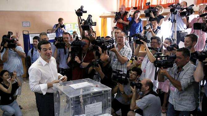 Head of Greece's radical left-wing Syriza party Alexis Tsipras casts his ballot at a voting center in Athens, Sunday, June 17, 2012. Greeks voted Sunday for the second time in six weeks in what was arguably their country's most critical election in 40 years, with the country's treasured place within the European Union's joint currency in the balance. (AP Photo/Petros Karadjias)