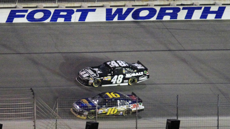 Driver Greg Biffle (16) passes Jimmy Johnson (48) taking the lead during the NASCAR Sprint Cup Series auto race at Texas Motor Speedway Saturday, April 14, 2012, in Fort Worth, Texas.  (AP Photo/John Rhodes)
