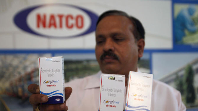 FILE – In this March 13, 2012 file photo, Natco Pharma Ltd. Secretary and General Manager Legal and Corp. Affairs M. Adinarayana displays Sorafenib Tosylate drugs meant for cancer treatment, at the company's head office in Hyderabad, India. India's patent appeals office on Monday, March 4, 2013, rejected international drug maker Bayer AG's plea to stop Indian company Natco Pharma Ltd. from manufacturing a cheaper generic version of a patented cancer drug. Bayer Corp., a subsidiary of the German pharma giant in Pittsburgh, Pennsylvania, markets sorefinib as Nexavar for about $5,600. Natco's version would cost Indian patients $175 a month. (AP Photo/Mahesh Kumar A., File)