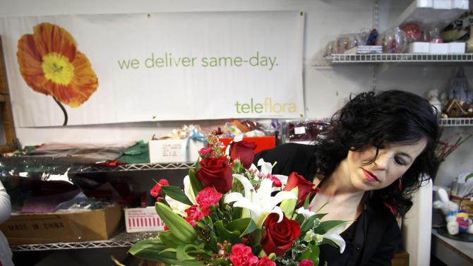 "Send Your Love Florist designer Rachel Barger designs Teleflora's Romantic Heartstrings Bouquet in Greensboro , N.C., Wednesday, Jan. 30, 2013.  Teleflora's ""Love Rocks"" sweepstakes launched on January 21 and runs until 10 p.m. (PST) February 10.  During the span of the sweeps, each time a customer places an order for a romantic Heartstrings Bouquet from teleflora.com, they will be automatically entered to win one of nine heart-shaped diamond necklaces valued at $15,000. Teleflora will select three lucky winners of a show-stopping diamond necklace every week leading up to Valentine's Day.  Get your orders in by Sunday night for the weekly Monday drawings starting January 28 with additional drawings on February 4 and February 11.  Orders placed early increase the odds of winning the lottery. (AP Images for Teleflora /Jim R. Bounds)"