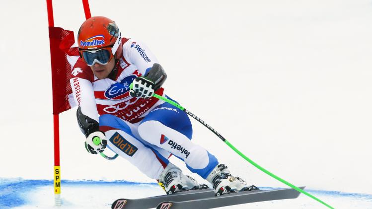 Kueng of Switzerland clears a gate during the men's World Cup Super-G skiing race in Val Gardena