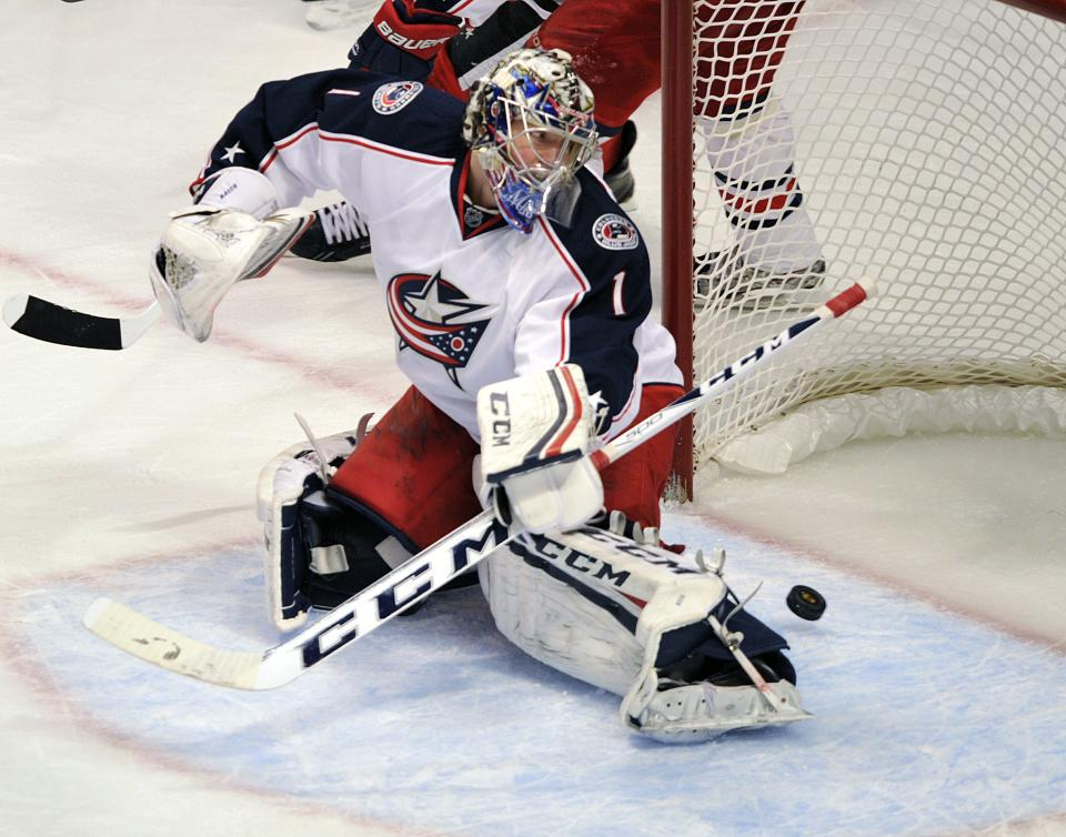 Columbus Blue Jackets' Steve Mason (1) watches the shot of the Chicago Blackhawks' Andrew Shaw dribble slide past him for a goal during the second period of an NHL hockey game Sunday, Feb. 24, 2013, in Chicago. (AP Photo/Jim Prisching)