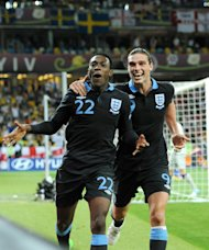 Danny Welbeck (left) and Andy Carroll (right) scored against Sweden