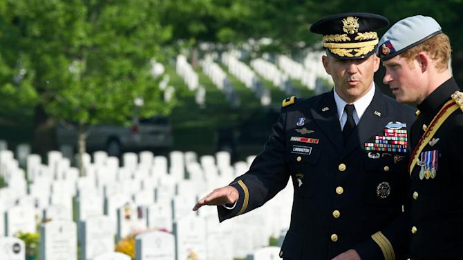 England's Prince Harry, right, speaks with US Army Major General Michael S. Linnington as he visits Section 60 of Arlington National Cemetery, where veterans of the wars in Iraq and Afghanistan are buried, in Virginia on May 10, 2013.    (AP PHOTO/Nicholas Kamm, Pool)