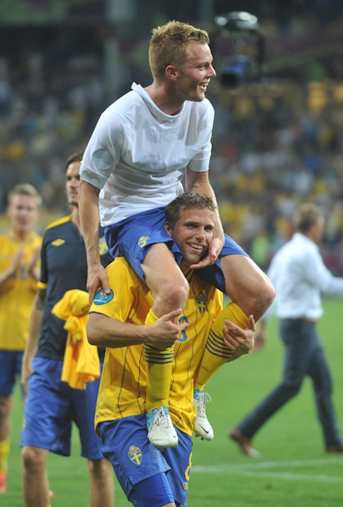 Swedish Midfielder Sebastian Larsson (top) And Midfielder Anders Svensson Celebrate At The End Of The Euro 2012  AFP/Getty Images