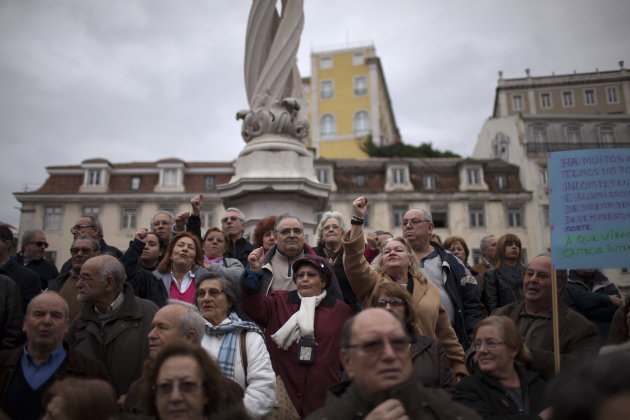 Demonstrators react during speeches at the end of an anti-austerity protest march in Lisbon Saturday, Feb. 16 2013. The protest was called by CGTP, the Portuguese confederation of workers unions. (AP