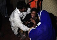 "A Pakistani woman mourns the death of relatives after a garment factory was engulfed in a fire in Karachi, on September 11. ""Rescue workers have recovered 240 dead bodies, we fear recovery of more bodies as rescue work continues,"" Karachi city's police chief told AFP"