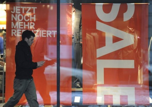 <p>A man walks past a storefront advertising sales in Berlin, January 2010. Eurozone retail sales slipped by 0.2 percent in July from the previous month, preliminary data released by the EU statistics unit Eurostat showed, after a slight rise of 0.1 percent in June.</p>