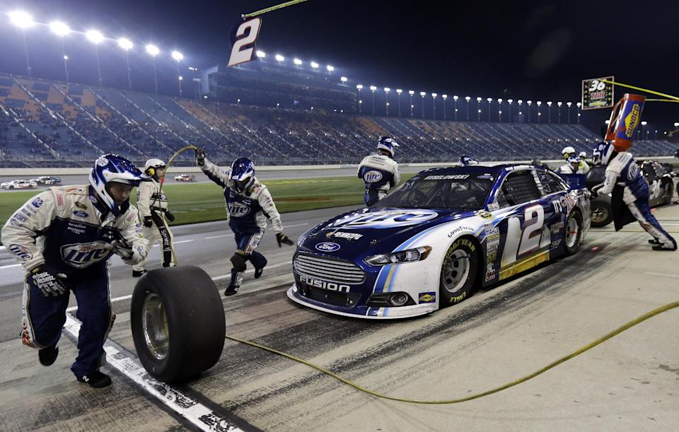 Brad Keselowski (2) makes a pit stop during the NASCAR Sprint Cup series auto race at Chicagoland Speedway in Joliet, Ill., Sunday, Sept. 15, 2013. (AP Photo/Nam Y. Huh)