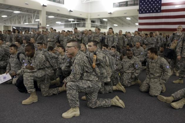 U.S. Army soldiers from 1st Brigade, 3rd Infantry Division, gather for a briefing after arriving at Hunter Army Airfield in Savannah, Ga. after an 18-hour journey home from a yearlong deployment in Ir