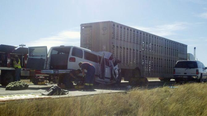 This photo provided by the Colorado State Patrol shows the scene of an accident near Kit Carson, Colo., on Thursday, Oct. 13, 2011, where five children and an adult were killed  when a van carrying children collided with a tractor-trailer rig. The photo shows the front of the van crumpled into the rear of a large livestock trailer. Kiowa County sheriff's spokesman Chris Sorensen said the van collided with the rear of the truck on U.S. 287 south of Kit Carson, which is about 130 miles southeast of Denver. (AP Photo/Colorado State Patrol)