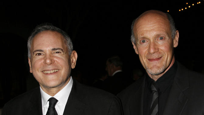 "FILE - This Nov. 15, 2007 file photo shows Craig Zadan, left, and Neil Meron, producers of the film ""Hairspray"" at the Santa Barbara International Film Festival's in Santa Barbara, Calif. Academy Awards producers Zadan and Meron announced Monday, Feb. 11, 2013, that Renee Zellweger, Catherine Zeta Jones, Queen Latifah and Richard Gere will return to the stage where ""Chicago"" won best picture in 2003. Zadan and Meron also produced the film. The 85th annual Academy Awards will be presented Feb. 24, 2013, at the Dolby Theatre and broadcast live on ABC.  (AP Photo/Michael A. Mariant, File)"