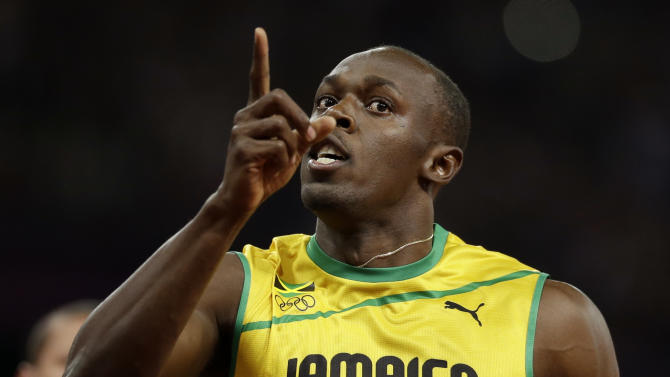 Jamaica's Usain Bolt holds up one finger after finishing first in the men's 100-meter final during the athletics in the Olympic Stadium at the 2012 Summer Olympics, London, Sunday, Aug. 5, 2012.(AP Photo/Anja Niedringhaus)