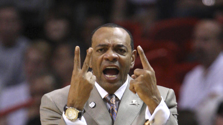 Memphis Grizzlies head coach Lionel Hollins calls out a play during the first half of an NBA basketball game against the Miami Heat, Friday, April 6, 2012 in Miami. (AP Photo/Wilfredo Lee)