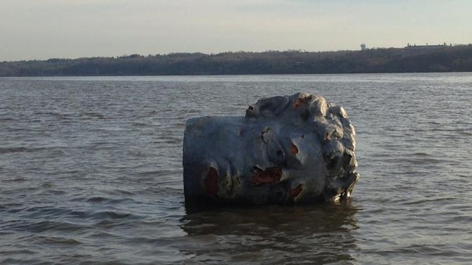 In this April 22, 2013 handout photo provided by Marist College crew coach Matthew Lavin, a giant head made of Styrofoam and fiberglass is seen floating in the Hudson River in Poughkeepsie, N.Y. Officials at the college in say their crew team was practicing earlier this week when the coach spotted a large object floating near the river's west bank. He hooked a rope to it and towed it to the team's dock on the east bank. (AP Photo/Marist College, Matthew Lavin, HO)
