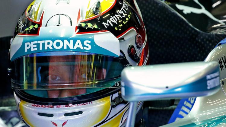 Hamilton sits in his car during a practice session at the Belgian F1 Grand Prix in Spa Francorchamps
