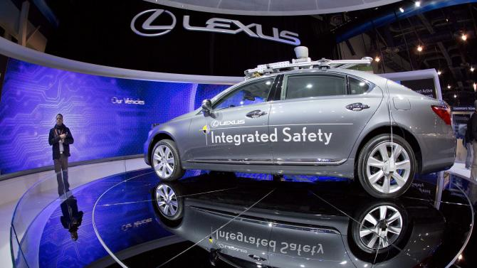 FILE - In this Wednesday, Jan. 9, 2013, file photo, a Lexus SL 600 Integrated Safety driverless research vehicle is seen on display at the Consumer Electronics Show, in Las Vegas. Now, two years after Google invented one, California and other U.S. states are rewriting the rules of the road to make way for driverless cars, leaving a growing number of technologists and economists to wonder what happens to the millions of people who make a living driving cars and trucks. (AP Photo/Julie Jacobson, File)