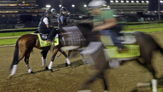 Exercise rider Jonny Garcia gets ready to take Kentucky Derby entrant Goldencents for a workout at Churchill Downs Friday, May 3, 2013, in Louisville, Ky. Saturday will be the 139th running of the Kentucky Derby. (AP Photo/Morry Gash)