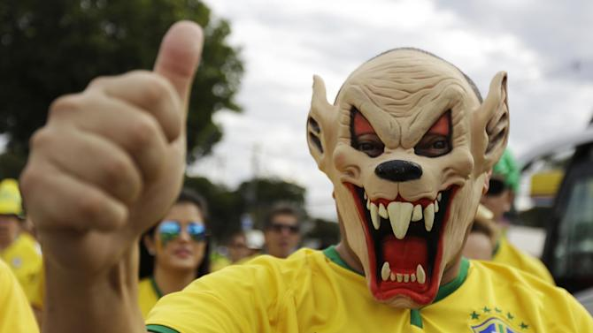 A Brazil supporter arrives at the Mineirao Stadium for the World Cup semifinal soccer match between Brazil and Germany in Belo Horizonte, Brazil, Tuesday, July 8, 2014. (AP Photo/Natacha Pisarenko)
