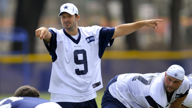 Dallas Cowboys quarterback Tony Romo directs his offense as they prepare to run a play during NFL football training camp, Tuesday, July 31, 2012, in Oxnard, Calif. (AP Photo/Gus Ruelas)