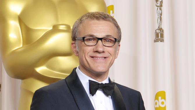 "Actor Christoph Waltz poses with his award for best actor in a supporting role for ""Django Unchained"" during the Oscars at the Dolby Theatre on Sunday Feb. 24, 2013, in Los Angeles. (Photo by John Shearer/Invision/AP)"