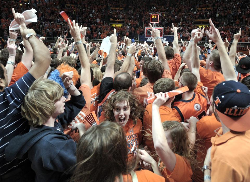 Illinois fans celebrate after Illini upset No. 1-ranked Indiana  74-72 in an NCAA college basketball game at Assembly Hall in Champaign, Ill., on Thursday Feb. 7, 2013. (AP Photo/John Dixon)