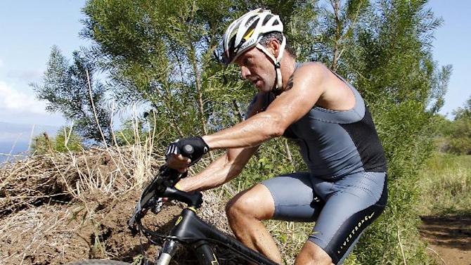 Lance Armstrong competes during the 2011 XTERRA World Championship triathalon on Sunday, Oct. 23, 2011, in Kapalua, Hawaii. Armstrong finished 23rd. (AP Photo/Wayne Jones)