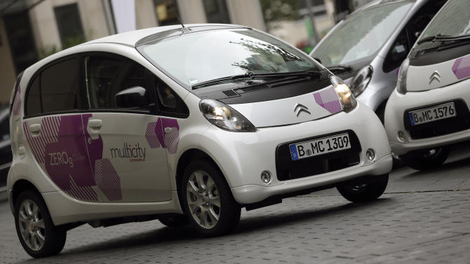 In this photo taken Wednesday, Sept. 5, 2012, Citroen C-Zero electric cars are pictured during the introducing of the 'Citroen Multicity Car Sharing' project in Berlin, Germany. First they ignored it, then they jumped on board. Now some German automakers are switching gears to take car sharing from city streets to the Autobahn, a maneuver that's being closely watched by others who wonder whether it could turn out to be a dead end for the industry. (AP Photo/Michael Sohn)