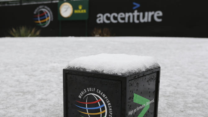 A tee marker sits in frozen snow on the first tee before play resumes for the first round of the Match Play Championship golf tournament, Thursday, Feb. 21, 2013, in Marana, Ariz. A snow storm blanketed the course on Wednesday suspending the first round of play and postponing it until late Thursday morning. (AP Photo/Ted S. Warren)