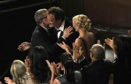 Director Quentin Tarantino, right, hugs Christoph Waltz, left, after Waltz is announced as the winner of the award for best actor in a supporting role for &quot;Django Unchained&quot; during the Oscars at the Dolby Theatre on Sunday Feb. 24, 2013, in Los Angeles. (Photo by Chris Pizzello/Invision/AP)