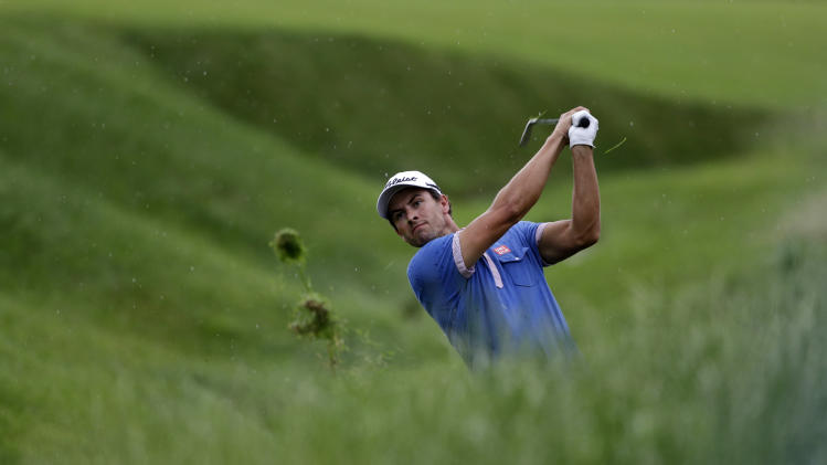 Adam Scott, of Australia, hits on the fifth hole during the first round of the U.S. Open golf tournament at Merion Golf Club, Thursday, June 13, 2013, in Ardmore, Pa. (AP Photo/Darron Cummings)