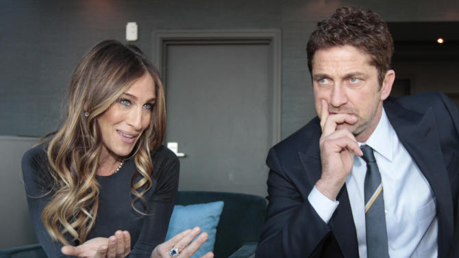U.S. actress Sarah Jessica Parker, left, and Scottish actor Gerard Butler are interviewed by the Associated Press, ahead of hosting the Nobel Peace Prize Concert in Oslo, Norway, Tuesday Dec. 11, 2012. The Nobel Peace Prize Committee awarded the prize to the European Union for its efforts to promote peace and democracy in Europe, despite being in the midst of its biggest crisis since the bloc was created in the 1950's. (AP Photo/Yves Logghe)