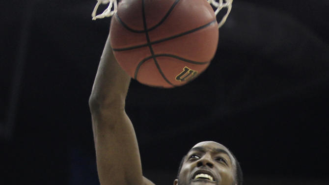North Carolina State's C.J. Leslie dunks the ball against San Diego State during the first half of an NCAA men's college basketball tournament second-round game  in Columbus, Ohio, Friday, March 16, 2012. (AP Photo/Tony Dejak)