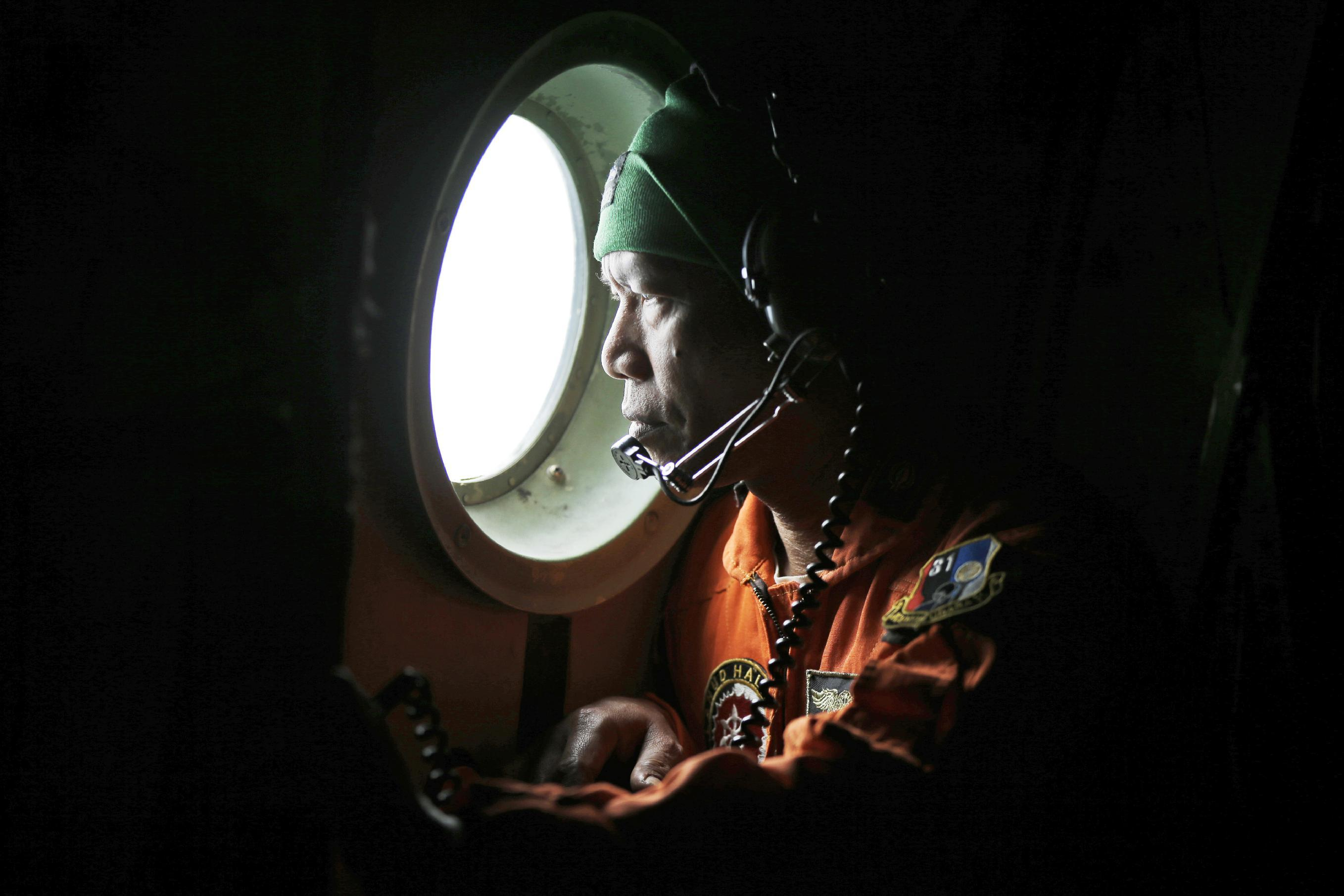 Unclear whether oil, objects found in sea linked to lost jet