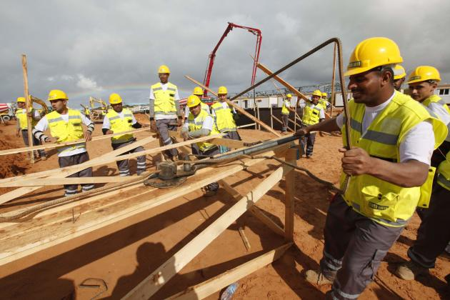 Labourers work at the construction site of the National Stadium that will host the 2017 Africa Cup of Nations in Tripoli