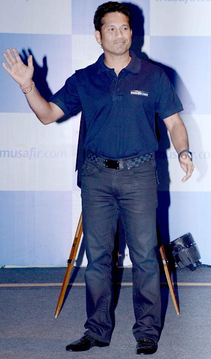 Sachin Tendulkar waves at a product launch