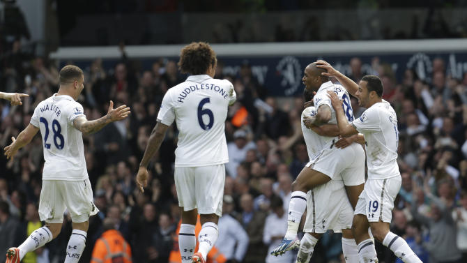 Tottenham Hotspur's Jermain Defoe, 2nd right, celebrates with his teammates after scoring against Manchester City during their English Premier League soccer match at White Hart Lane in London, Sunday, April 21, 2013. Tottenham Hotspur won the match 3-1. (AP Photo/Lefteris Pitarakis)