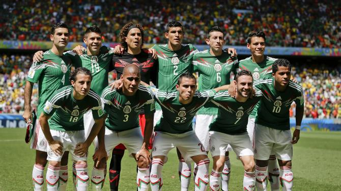 FILE - In this June 29, 2014, file photo, Mexico's national team poses before the World Cup round of 16 soccer match between the Netherlands and Mexico at the Arena Castelao in Fortaleza, Brazil. Mexico's national team will play a friendly match against Costa Rica on June 27, 2015 at the Cirtus Bowl  in Orlando, Florida. (AP Photo/Felipe Dana, File)