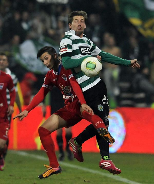 Sporting's Adrien Silva, right, vies for the ball with Gil Vicente's Luis Martins in a Portuguese League soccer match at the Cidade de Barcelos stadium, Barcelos, northern Portugal, Sunday, De
