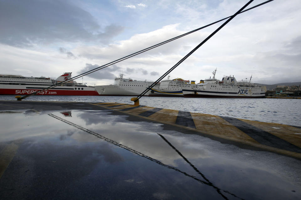 Ships are docked in the port of Piraeus, near Athens, during a 24 hour strike on Tuesday, Feb. 7, 2012. Unions have called a 24-hour general strike for Tuesday, in response to the new austerity measure. (AP Photo/Petros Giannakouris)