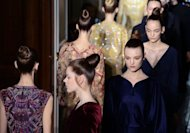 Models present creations for Valentino during the Haute Couture Fall-Winter 2012-2013 collections shows in Paris