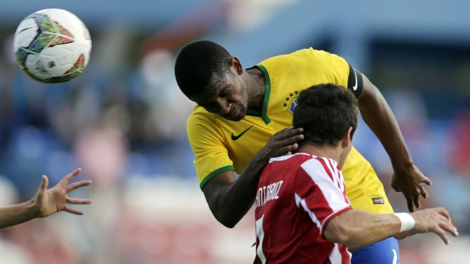 Brazil's Marlon jumps for the ball with Paraguay's Santacruz during their South American Under-20 Championship final round soccer match in Montevideo